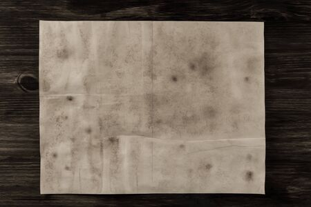 aged: sheet old vintage paper on the aged wooden background