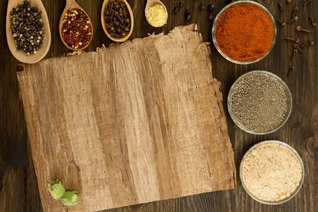 recipe background: sheet old vintage paper with spices on wooden background Stock Photo