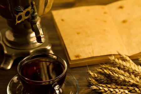 samovar: Tea still life with samovar, maple leaves, on wooden background