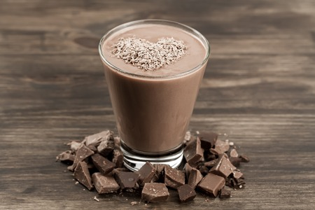 chocolate shake: delicious chocolate shake with heart on wooden background