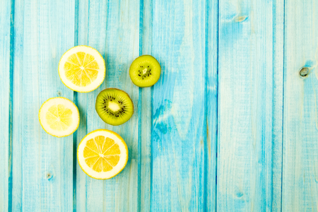 orange peel clove: Ripe lemon, kiwi fruit on wooden vintage background. Healthy vegetarian food. Recipe, menu, mock up, cooking.