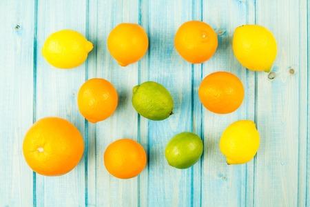 orange peel clove: Ripe orange, lime fruit on wooden vintage background. Healthy vegetarian food. Recipe, menu, mock up, cooking.