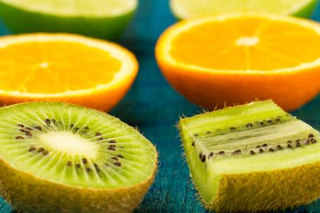 orange peel clove: Ripe orange, kiwi, lime fruit on wooden vintage background. Healthy vegetarian food. Recipe, menu, mock up, cooking.