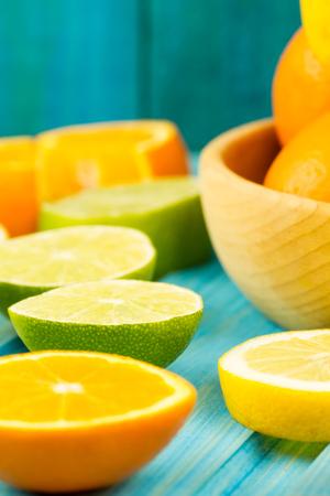 orange peel clove: Ripe kiwi, lime, lemon, orange fruit on wooden vintage background. Healthy vegetarian food. Recipe, menu, mock up, cooking.