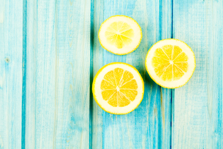 Ripe lemon fruit on wooden vintage background. Healthy vegetarian food. Recipe, menu, mock up, cooking.