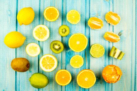 orange peel clove: Ripe orange. kiwi, lemon. lime fruit on wooden vintage background. Healthy vegetarian food. Recipe, menu, mock up, cooking. Stock Photo