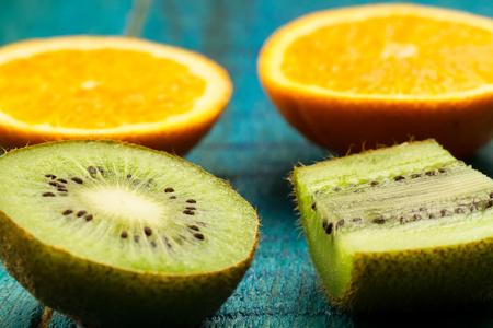 orange peel clove: Ripe orange, kiwi fruit on wooden vintage background. Healthy vegetarian food. Recipe, menu, mock up, cooking. Stock Photo