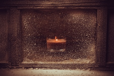 natural light: Frosted winter window. One light candle