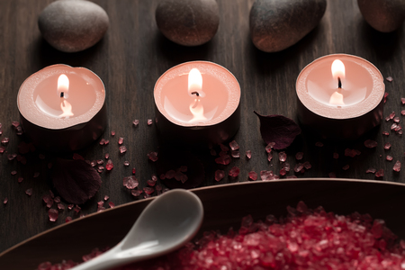 Beautiful Spa composition with aroma candles on wooden . Treatment, aromatherapy Stock Photo - 52286407