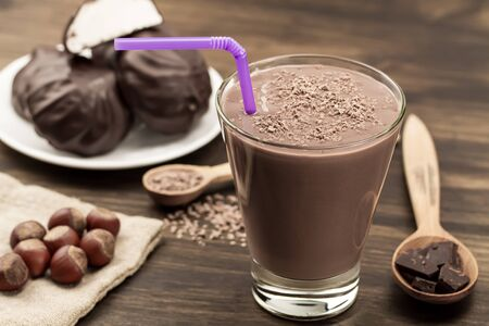 chocolate shake: delicious chocolate shake with heart on wooden background. Cocktail, smoothies Stock Photo