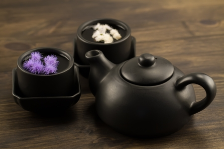 Black teapot, two cups, flowers. Menu, recipe