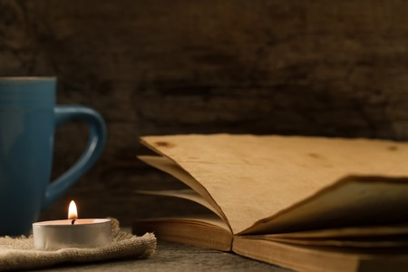 light  burning brightly candles on old wooden background. Spa, meditation, ritual, flavored. writing Desk