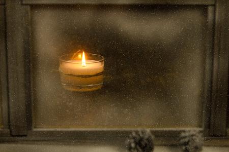 Winter window. Cozy room. Candlesticks on a windowsill.