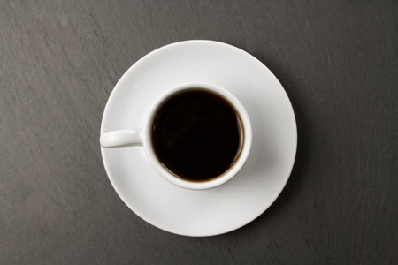 white black Cup of coffee on a black background. Standard-Bild