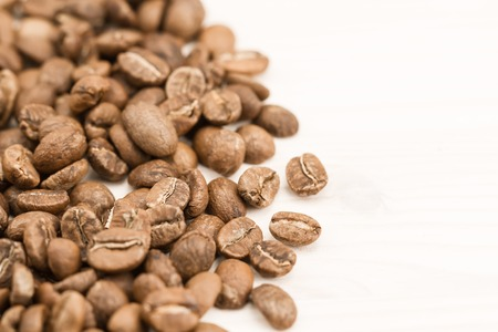 Background coffee. Roasted beans on old wooden background
