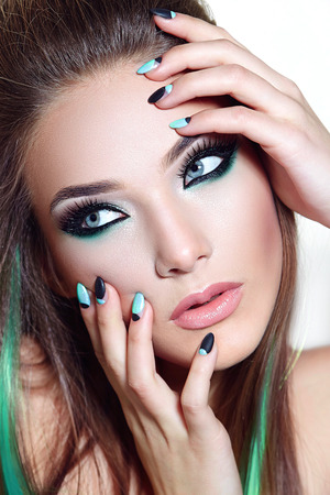 fashion girl: A girl with bright makeup. Black and white nails. Manicure. Stock Photo