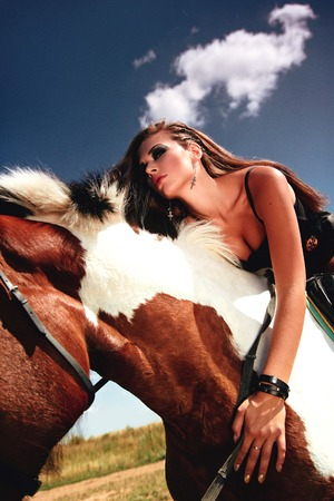accessories horse: Girl and horse. Horse. rider. Astride a horse. Trendy hairstyles. Beautiful make-up. Beautiful face. Beautiful girl.