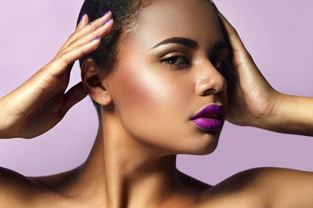 matte: Mulatto with purple lipstick and lipstick nails Stock Photo