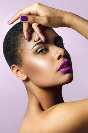 Mulatto with purple lipstick and lipstick nails