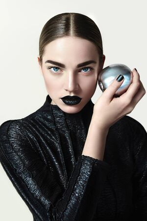 The girl with a silver apple in hand.