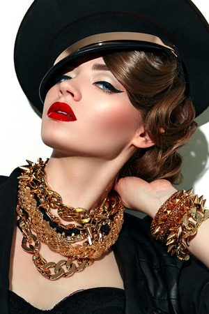 Girl in military cap with red lips gold ornaments in the style of steam-punk. Military fashion. Stock Photo