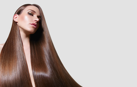 Very long, straight silky hair. The girl with long hair. Keratin straightening. Hair care.