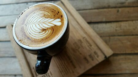 art: Beautiful latte art on cup of hot cappuccino. Stock Photo