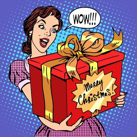 historietas: Mujer con estilo retro del arte pop regalo de Navidad. hermosa chica con una caja roja grande con las palabras Feliz Navidad. Celebraciones y felicitaciones. Familia y alegría