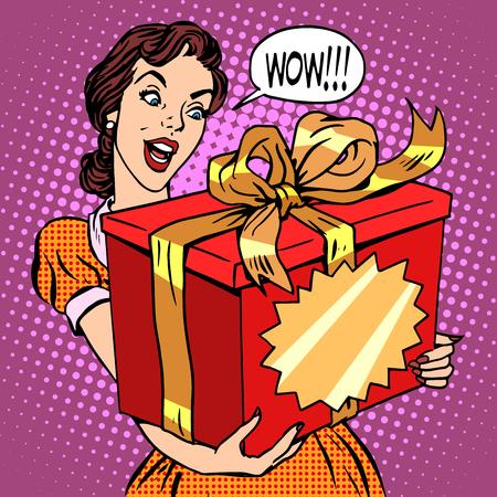女性と大きなギフト ボックスはポップ アート レトロなスタイルです。誕生日や休日。国際女性の日