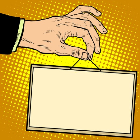 holding sign: Hand holding a sign pop art retro style. Advertising signs. Vector business concept