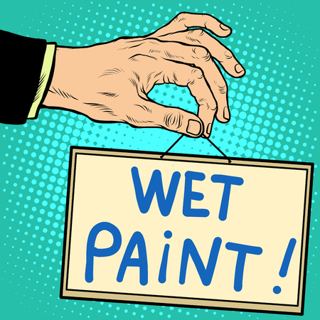 wet paint: Hand holding a sign wet paint pop art retro style. Advertising signs. Vector business concept Stock Photo