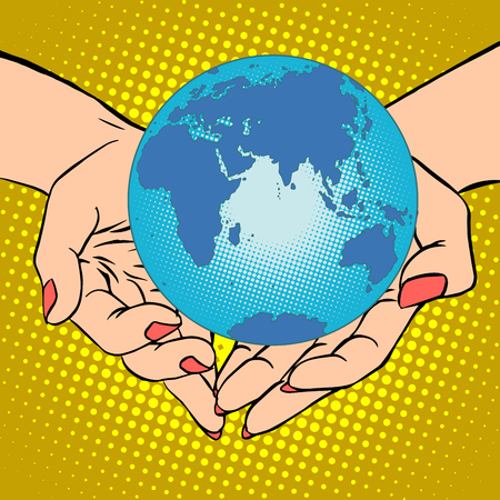 eurasia: Planet Earth in hands pop art retro style. Earth day, environment Day. Ecology and nature. Female hands. Eurasia, Africa, Australia and Antarctica
