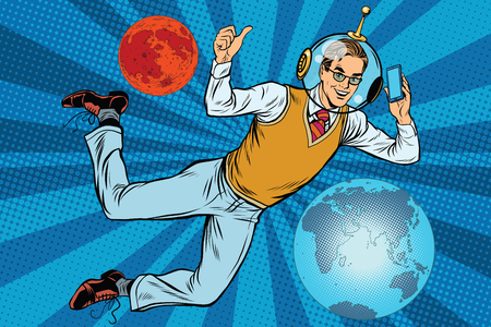Space businessman with smartphone over the planet Earth and Mars pop art retro vector. New technology. science fiction. Male astronaut. Space business 矢量图像
