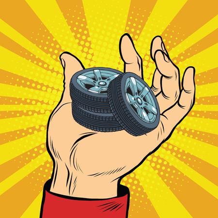 retro illustration: Hand with car tires pop art retro comic book vector illustration. sale of spare parts