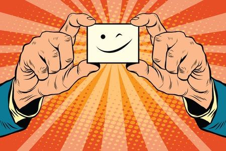 knipoog Smiley gezicht in handen, pop art retro vector illustratie