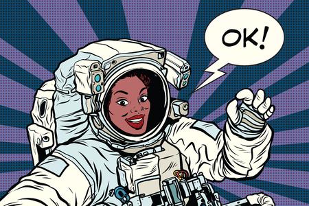 OK geste femme astronaute dans une combinaison spatiale, pop art rétro bande dessinée illustration vectorielle