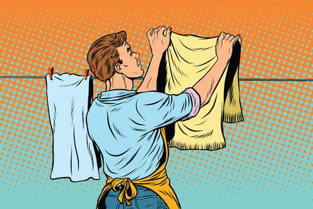 Vintage employee hangs up to dry clothes