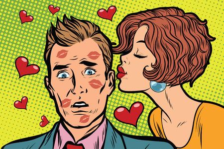 Beautiful woman kissing a man, trace of lipstick
