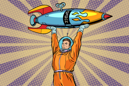 An Astronaut holding a space rocket. Pop art retro vector Illustrator