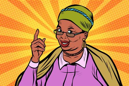Donna anziana africana che indica barretta in su