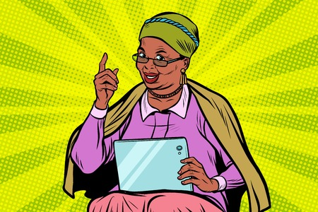 African elderly woman with a tablet