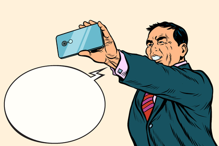 Asian businessman makes selfie Stock Photo