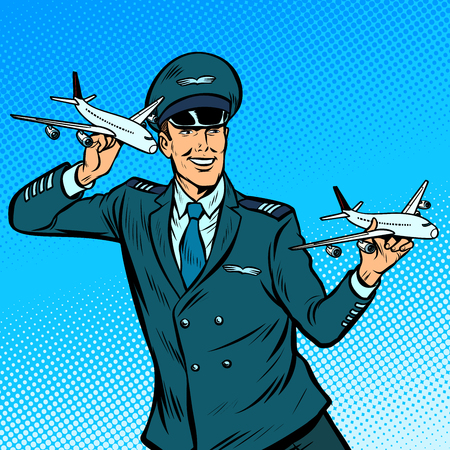 male airplane pilot. Model aircraft in hand