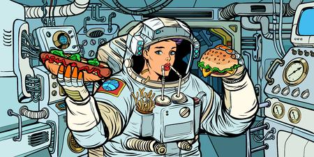 Mujer astronauta come en una nave espacial