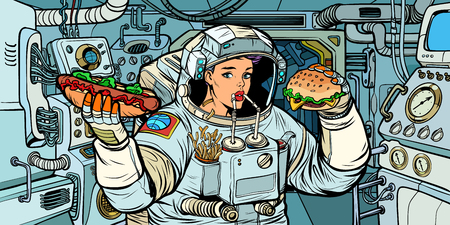 Woman astronaut eats in a spaceship