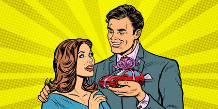 man and woman, car gift. Pop art retro vector illustration drawing kitsch vintage