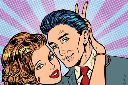 woman puts horns to man, hand gesture joke. Pop art retro vector illustration vintage kitsch