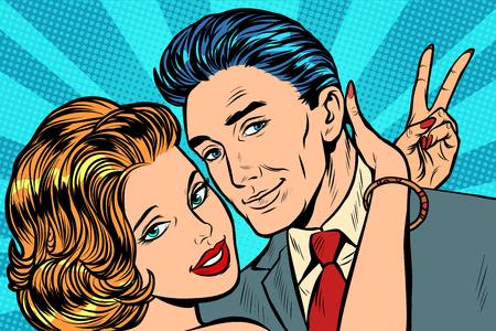 couple in love hugs victory gesture. Pop art retro vector illustration vintage kitsch Illustration