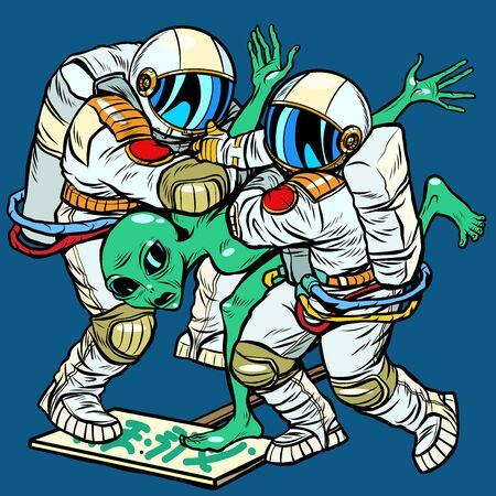 Astronauts arrested an alien. Pop art retro vector illustration drawing