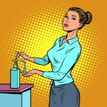 a woman uses a hand sanitizer